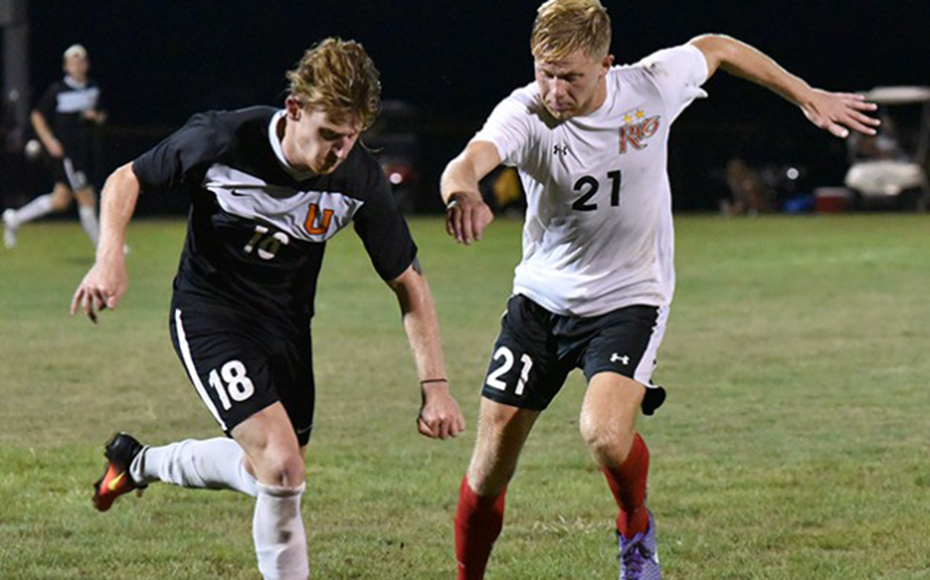 Jeremy de Hoog (right) defends against Union at the NAIA quarterfinal game.