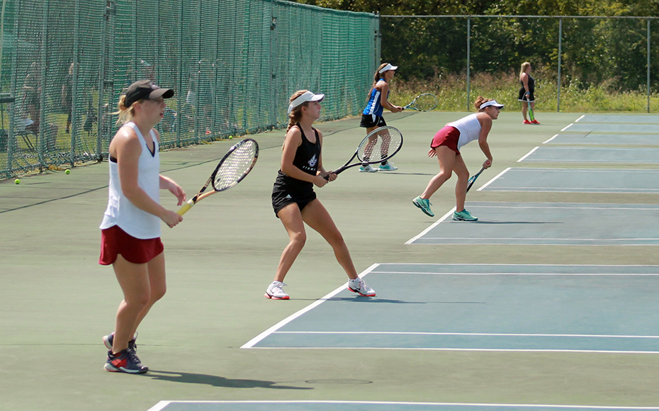 RSC women's tennis players in action Friday at Asbury. Photo by John Minor.